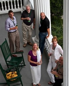 Here, Whit (left) is standing with a group of Members at the Bellamy Mansion in Wilmington, NC.